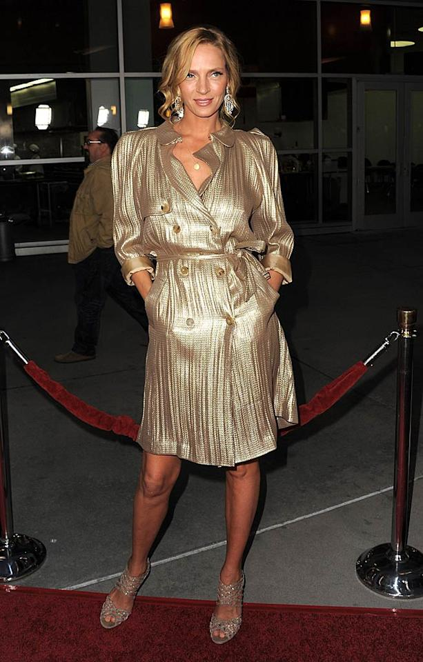 """Some of the time, Uma Thurman looks hot. Other times, she definitely does not. What do you make of the metallic Lanvin coat dress and crystal-encrusted Jimmy Choo sandals the """"Kill Bill"""" actress recently wore to a movie premiere in Hollywood? Is her gold trench trendy or tacky? Jordan Strauss/<a href=""""http://www.wireimage.com"""" target=""""new"""">WireImage.com</a> - March 22, 2011"""