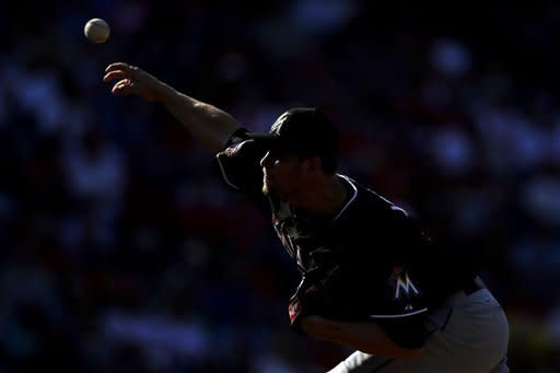 Miami Marlins' Josh Johnson pitches in the first inning of a baseball game against the Philadelphia Phillies, Wednesday, Sept. 12, 2012, in Philadelphia. (AP Photo/Matt Slocum)