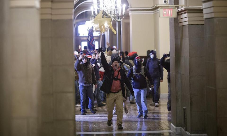 Demonstrators breach barricades to enter the Capitol.