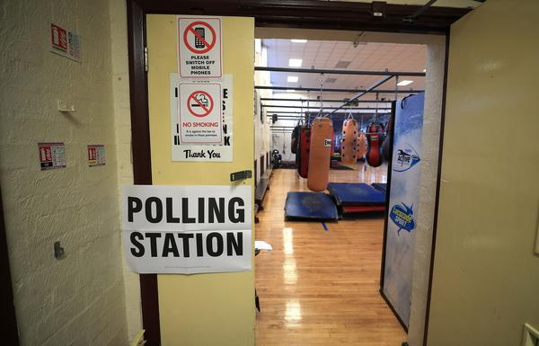 <p>This gym in Liverpool has doubled up as a polling booth – with voters fighting for their party (Picture: PA) </p>