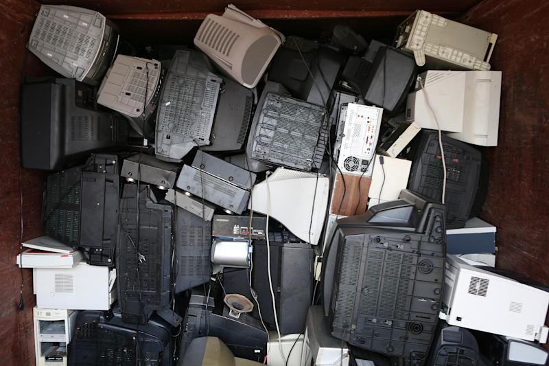 FILE - In this Feb. 4, 2013 file photo discarded television sets and computer monitors are piled in a consolidated container for electronic scrap at the Bahrenfeld recycling park in Hamburg, Germany. The mountain of refrigerators, cellphones, TV sets and other electrical waste disposed of annually worldwide is forecast to grow by a third in the next five years, according to a United Nations study released Sunday, Dec. 15, 2013. (AP Photo/dpa, Christian Charisius, File)
