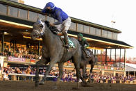 Jockey Luis Saez reacts aboard Essential Quality as they win the Breeders' Cup Juvenile horse race at Keeneland Race Course, Friday, Nov. 6, 2020, in Lexington, Ky. (AP Photo/Darron Cummings)