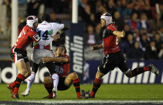 Taku Ngwenya of Biarritz (2nd L) is tackled by Matt Giteau of Toulon (L) and Jonny Wilkinson of Toulon (2ndR) during the European Challenge Cup Final Rugby Union match between Toulon and Biarritz at Twickenham Stoop in Twickenham, England, on May 18, 2012. AFP PHOTO / IAN KINGTONIAN KINGTON/AFP/GettyImages