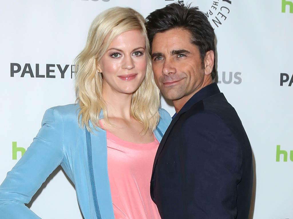 "Georgia King and John Stamos attend the 30th annual PaleyFest featuring the cast of ""The New Normal"" at the Saban Theatre on March 6, 2013 in Beverly Hills, California."
