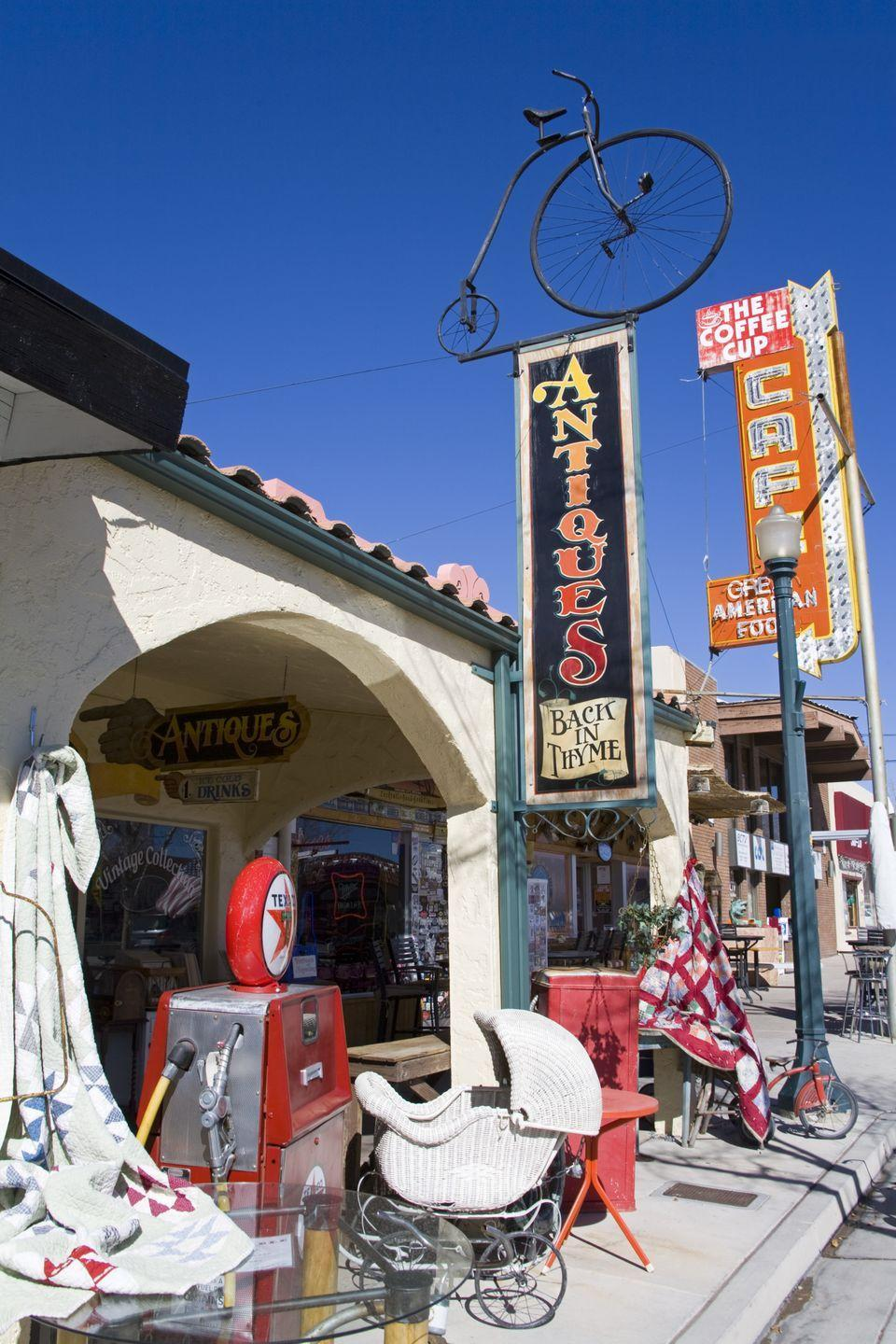 """<p>On the quirkier end of the spectrum is Boulder City, Nevada — a town of about 15,000 located approximately 26 miles from Las Vegas. At <a href=""""http://www.yelp.com/biz/antique-depot-boulder-city"""" rel=""""nofollow noopener"""" target=""""_blank"""" data-ylk=""""slk:The Antique Depot"""" class=""""link rapid-noclick-resp"""">The Antique Depot</a> and <a href=""""http://www.yelp.com/biz/antique-depot-boulder-city"""" rel=""""nofollow noopener"""" target=""""_blank"""" data-ylk=""""slk:Sherman's House of Antiques"""" class=""""link rapid-noclick-resp"""">Sherman's House of Antiques</a>, you can find everything from old neon signs to an antique washing machine.</p>"""