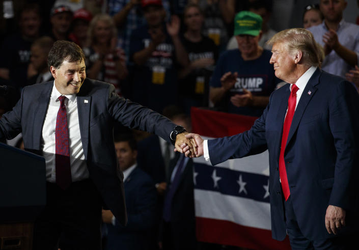 The 12th Congressional District Republican candidate Troy Balderson, left, reaches for President Donald Trump as he speaks at a rally at Olentangy Orange High School in Lewis Center, Ohio, Saturday, Aug. 4, 2018. (Photo:Carolyn Kaster/AP)