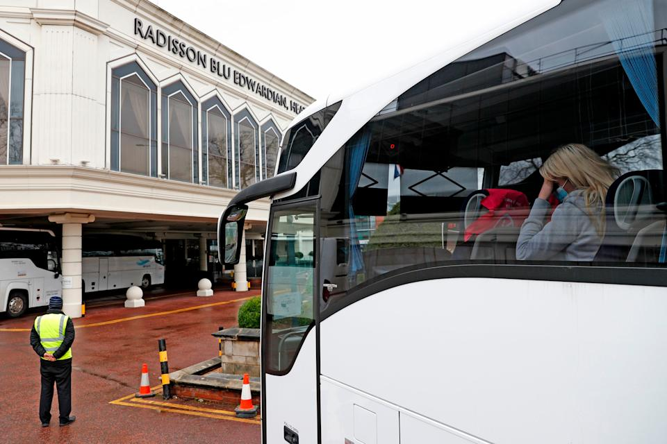 A woman arrives in a coach at the Radisson Blu hotel, where travellers are spending their mandatory hotel quarantine, at Heathrow Airport (Photo: Photo by ADRIAN DENNIS/AFP via Getty Images)