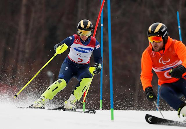 Alpine Skiing - Pyeongchang 2018 Winter Paralympics - Women's Slalom - Visually Impaired - Run 1 - Jeongseon Alpine Centre - Jeongseon, South Korea - March 18, 2018 - Millie Knight of Britain and her guide. REUTERS/Paul Hanna