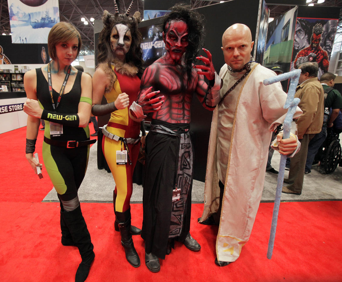 Characters from New-Gen New Dawn pose for a photo at New York Comic Con 2012 at New York's Jacob K. Javits Center,  Thursday, Oct. 11, 2012. The New York Comic Con show floor plays host to the latest and greatest in comics, graphic novels, anime, manga, video games, toys, movies, and television. (AP Photo/Richard Drew)