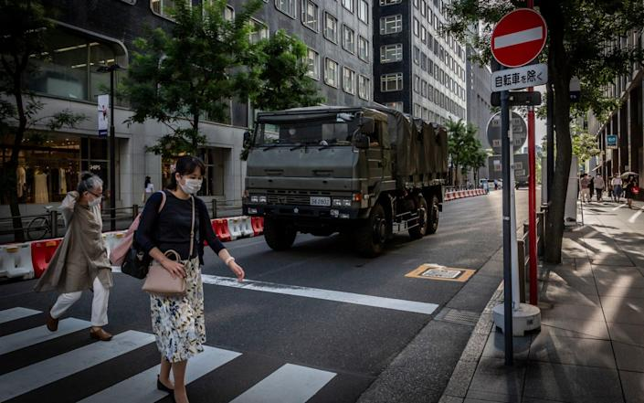 A Japan self-defence force vehicle arrives at Tokyo International Forum, one of the Tokyo 2020 Olympics venues amid warnings the Games could still yet be cancelled - Yuichi Yamazaki/Getty Images