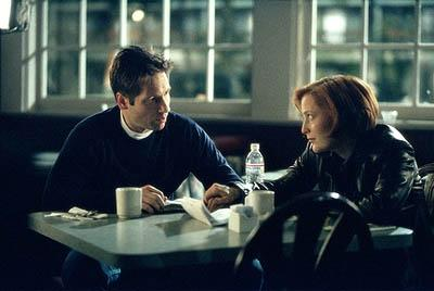 Mulder (David Duchovny, L) and Scully (Gillian Anderson, R) search for clues to the abduction of Mulder's sister on Fox's The X-Files X-Files