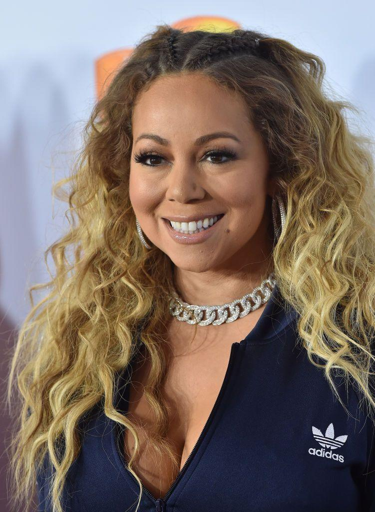 <p>Spice up your look with a couple of cornrows near the roots, like singer Mariah Carey.</p>