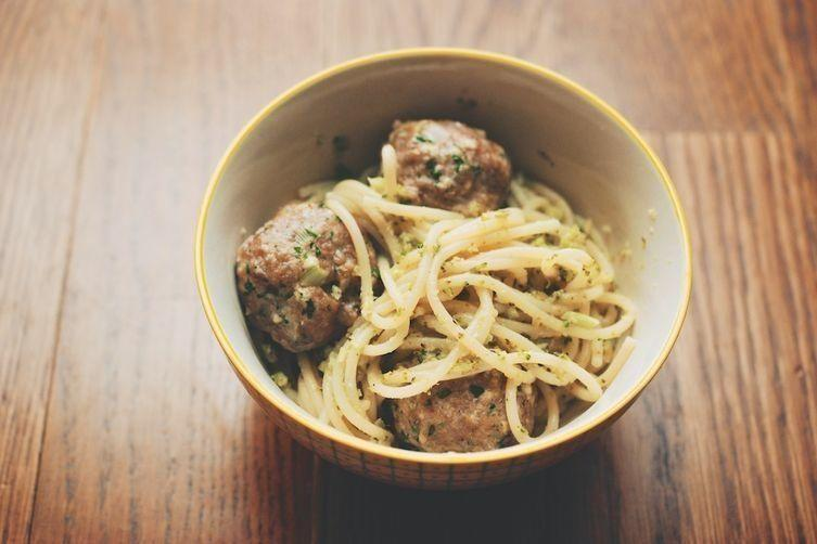 "<strong>Get the&nbsp;<a href=""http://food52.com/recipes/22389-roasted-broccoli-pesto-spaghetti-with-veal-ricotta-meatballs"">Roasted Broccoli Pesto Spaghetti with Veal-Ricotta Meatballs recipe</a>&nbsp;from&nbsp;Cristina Sciarra via Food52</strong>"