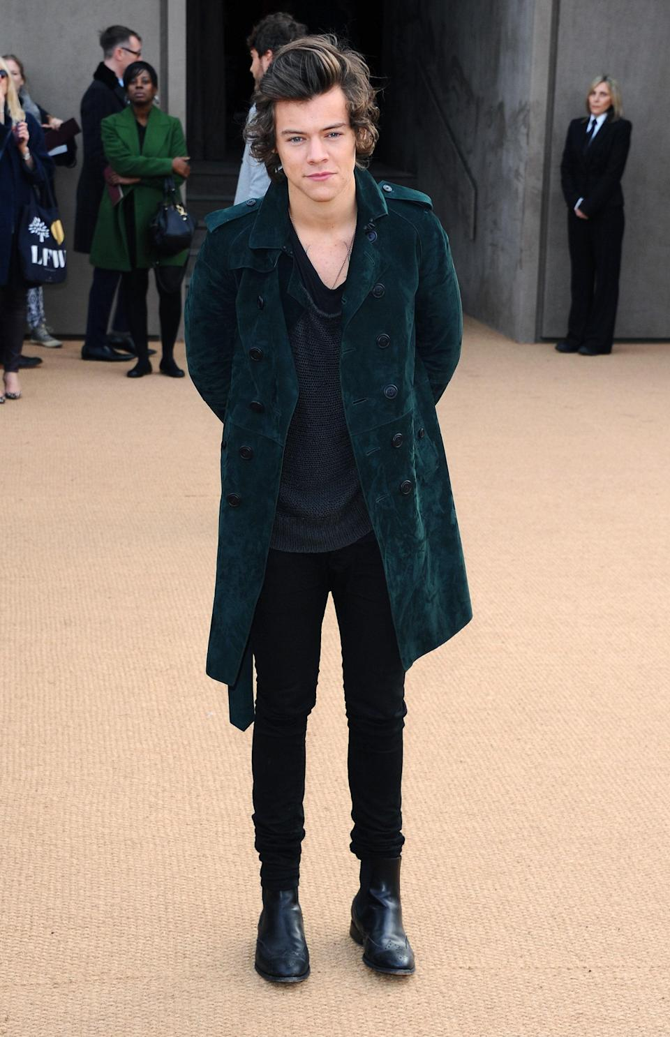 All it took was an emerald green suede trench over a simple black look, and Harry was good to go at London Fashion Week.