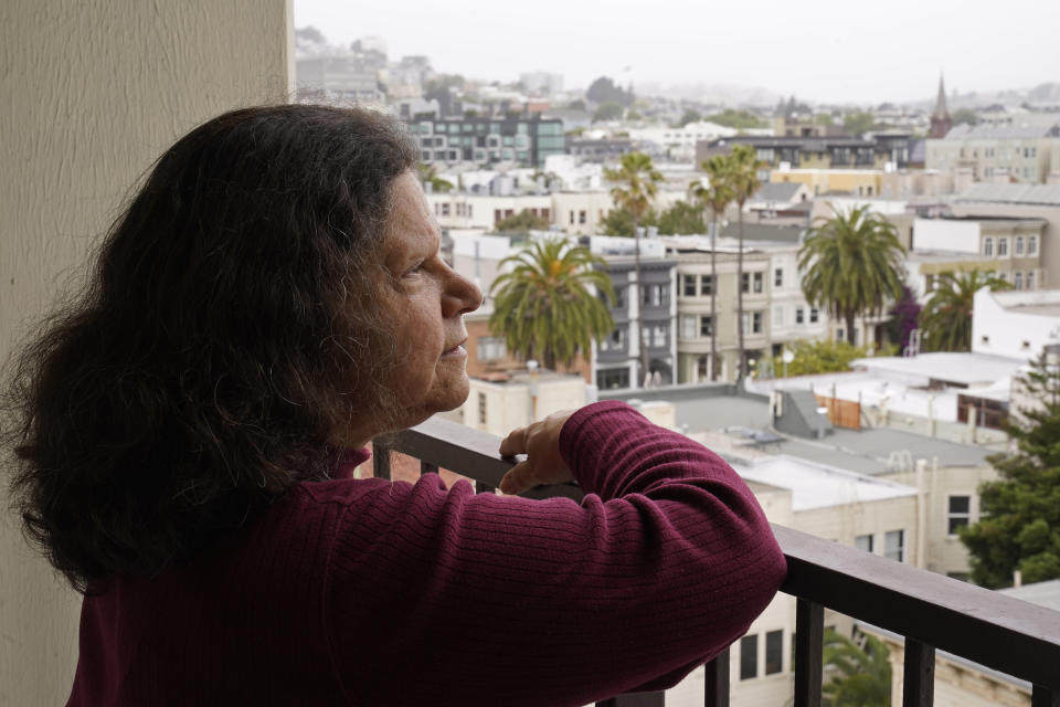 Census taker Linda Rothfield looks out at the Mission District area where she worked in San Francisco, on Wednesday, June 30, 2021. Some census takers worry that renters in apartment buildings were not tallied fully during the nation's head count last year. Census takers say they had difficulty entering apartment buildings due to COVID restrictions, and they weren't able to get in touch with landlords for help. (AP Photo/Eric Risberg)