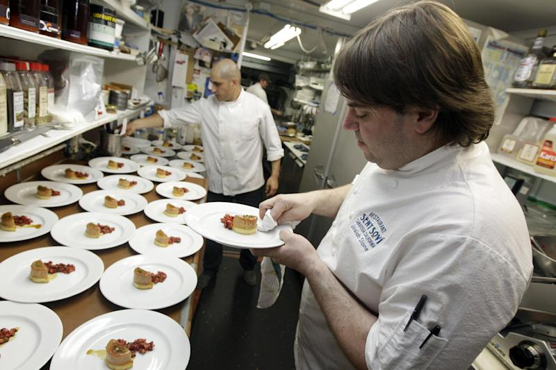 Chef and owner Josiah Slone, right, prepares a foie gras dish at Sent Sovi Friday, May 11, 2012 in Saratoga, Calif. This is not a good time to be a duck in California. As a July 1 deadline looms for foie gras nears, renegade chefs across the state are loading their menus with the fatty duck liver and even holding secret dinners to avoid protesters, who say that force-feeding ducks is cruel. (AP Photo/Marcio Jose Sanchez)