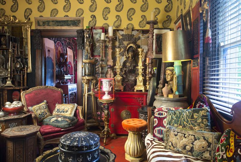 In Australian artist Gavin Brown's parlor, the riot of rich colors, married with velvets, silks, and antique tapestry cushions, creates an atmosphere that can only be truly appreciated after dusk. Gavin explained that as he is rarely in his apartment during the day, he designed it for evenings only—complete with red lacquer Chinese cabinet, Portuguese candlesticks, a wooden Quan Yin carving, and an early-19th-century French chair.