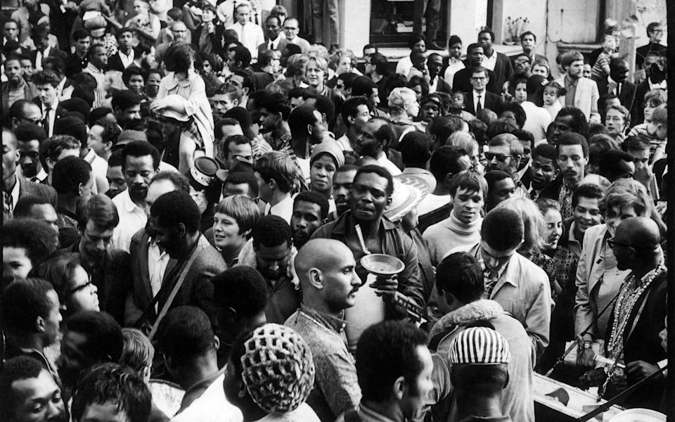 Crowds fill the street during the Notting Hill Carnival, London, August 1968. (Photo by Charlie Phillips/Getty Images)  - Getty