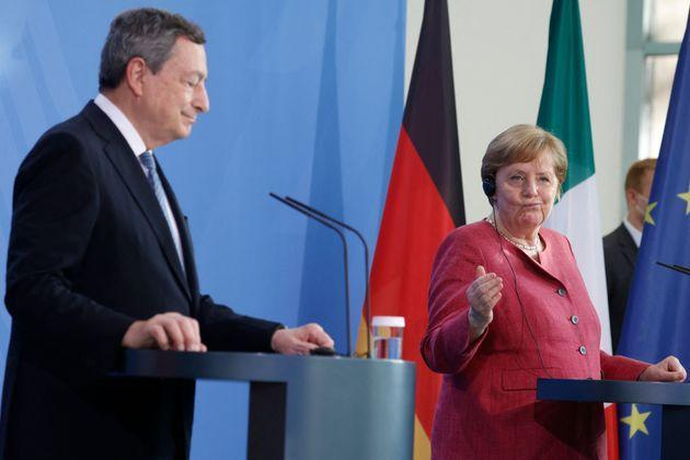 German Chancellor Angela Merkel (R) and Italy's Prime Minister Mario Draghi give a press conference after talks ahead of the Euro summit 2021 at the Chancellery in Berlin, on June 21, 2021. (Photo by Odd ANDERSEN / various sources / AFP) (Photo by ODD ANDERSEN/AFP via Getty Images) (Photo: ODD ANDERSEN via Getty Images)