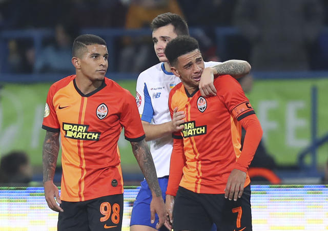 Shakhtar's Brazilian player Taison, right, is suspended one game for his reaction to fans' racism in Ukraine. (AP)