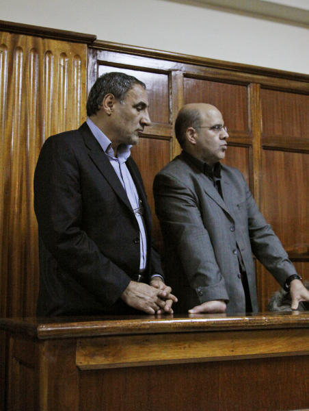 Iranian nationals Sayed Mansour Mousavi , left, and Ahmed Abolfathi Mohammed, right stand in the Nairobi magistrate court in Nairobi, Kenya, Wednesday, June 27, 2012. One of two Iranians facing charges related to accusations the two planned to carry out an attack with explosives in Kenya says he was interrogated by Israeli agents while in detention. Ahmad Abolfathi Mohammad also told a Kenyan court on Wednesday the Israeli agent tortured and injected him with chemicals without his consent. (AP Photo/Khalil Senosi)
