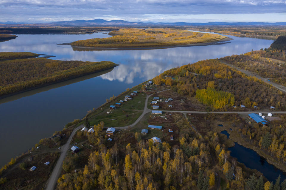 The Yukon River stretches past Stevens Village on Wednesday, Sept. 15, 2021, in Stevens Village, Alaska. Two salmon species have all but disappeared from Alaska's Yukon River this year, prompting the state to shut down fishing in an effort to save them. (AP Photo/Nathan Howard)