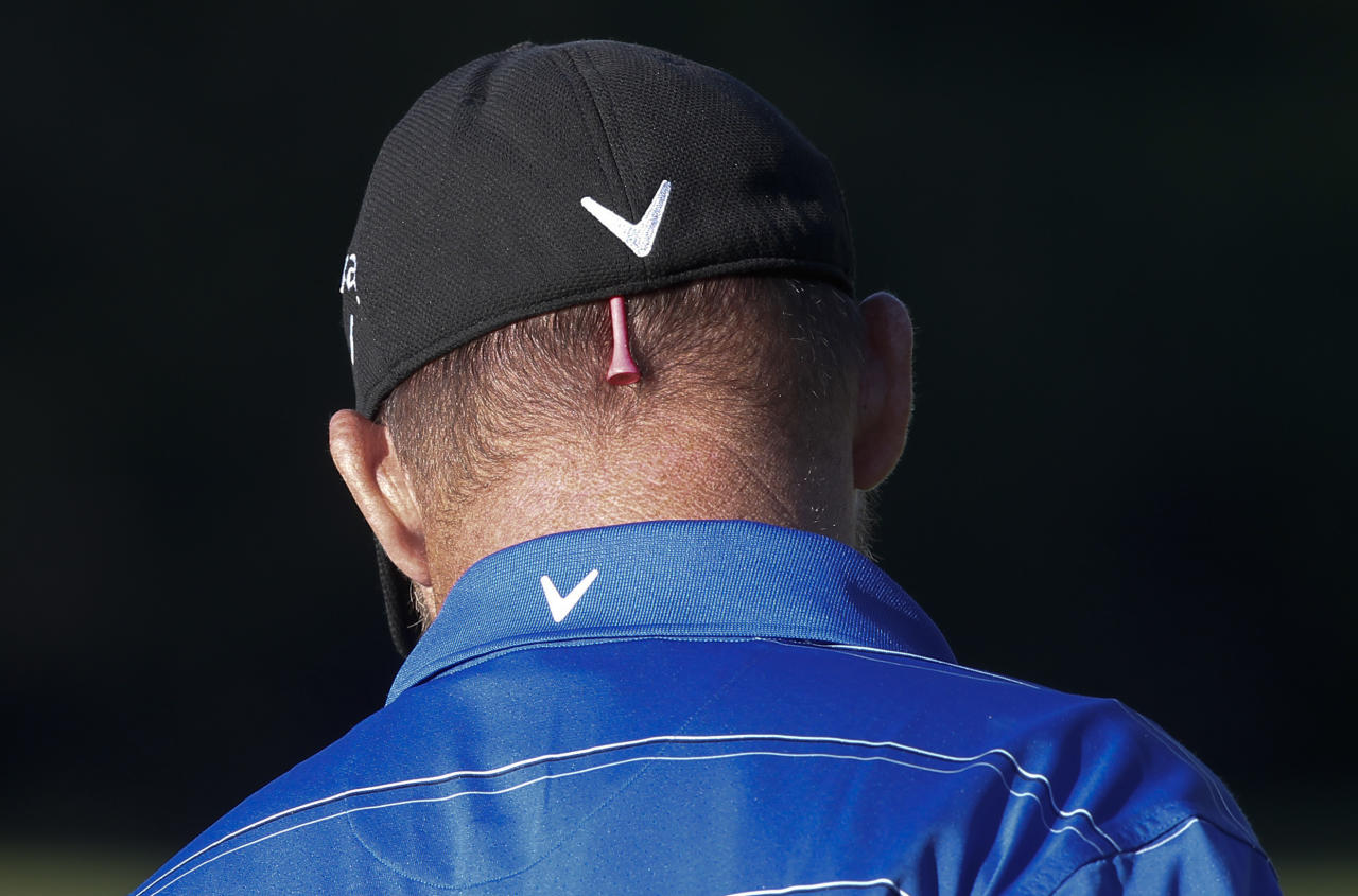 Tommy Gainey stores a spare golf tee in his cap during the first round of the Northern Trust Open golf tournament at Riviera Country Club in Los Angeles, Thursday, Feb. 16, 2012. (AP Photo/Chris Carlson)