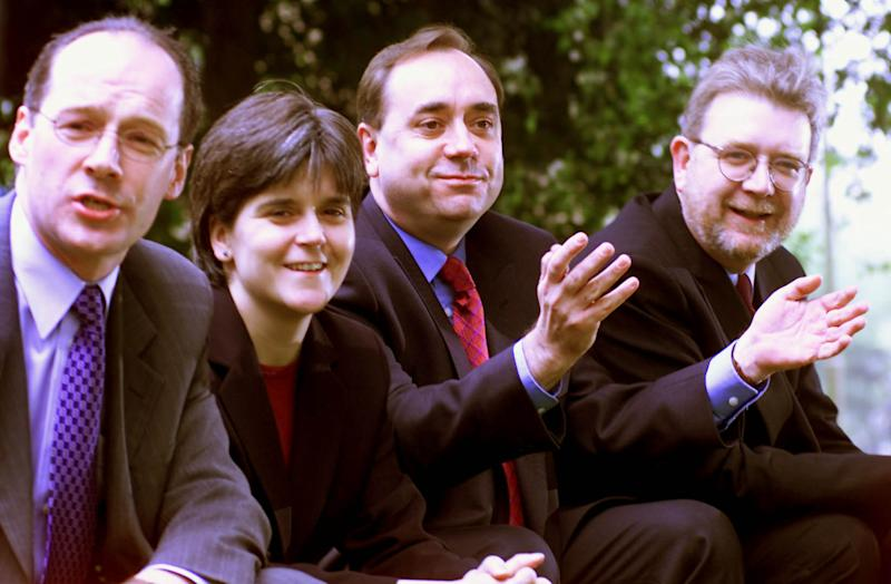 From left: SNP Deputy Convenor John Swinney, Vice Convenor Nicola Sturgeon, Leader Alex Salmond and Chief Executive Mike Russell sit down outside the Holiday Inn hotel in Edinburgh after a press conference held the day after Scottish parliamentary elections. (Photo by Ben Curtis - PA Images/PA Images via Getty Images)
