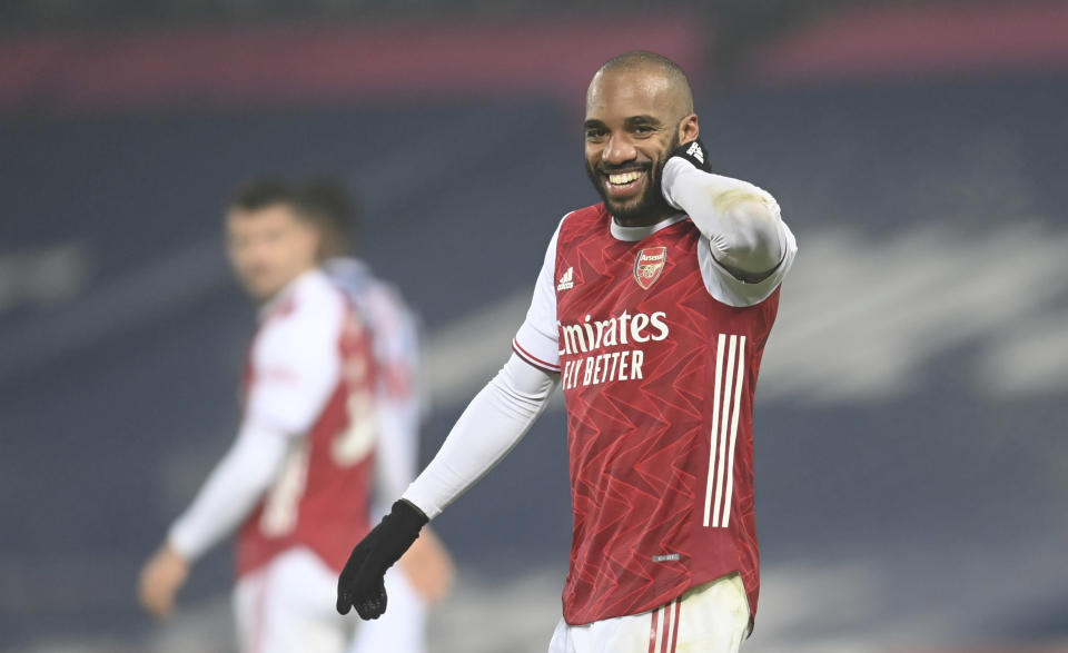 Arsenal's Alexandre Lacazette celebrates after scoring his sides 4th goal of the game during the English Premier League soccer match between West Bromwich Albion and Arsenal at the Hawthorns in Birmingham, England, Saturday, Jan. 2, 2021. (Michael Regan/ Pool via AP)