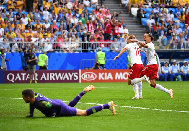 Soccer Football - World Cup - Group C - Denmark vs Australia - Samara Arena, Samara, Russia - June 21, 2018 Denmark's Christian Eriksen celebrates scoring their first goal with Yussuf Poulsen as Australia's Mathew Ryan reacts REUTERS/Dylan Martinez
