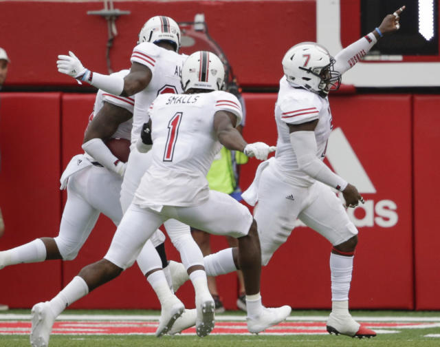 Jawuan Johnson (R) celebrates after scoring a touchdown on an interception of a throw by Nebraska quarterback Tanner Lee. (AP Photo/Nati Harnik)