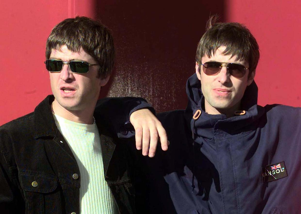 Liam Gallagher (R) and his songwriting brother Noel walk out of the concert hall for a photo-opportunity prior to the first date on their 1997 UK tou, September 13. Oasis's new record has gone straight to number one in the UK charts.  BRITAIN OASIS