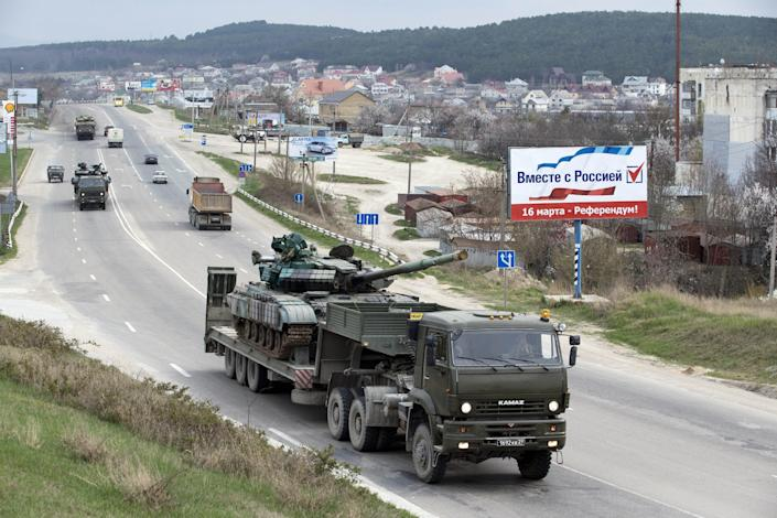 Ukrainian tanks are transported from their base in Perevalnoe, outside Simferopol, Crimea, Wednesday, March 26, 2014. Ukraine has started withdrawing its troops and weapons from Crimea, now controlled by Russia. (AP Photo/Pavel Golovkin)