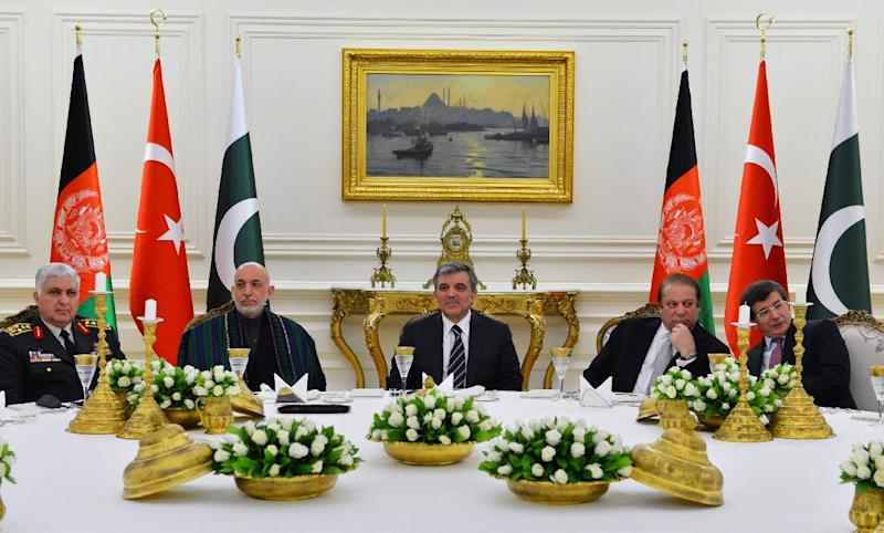 In this photo released by the Turkish Presidency Press Office, Turkish Abdullah Gul, center, Afghan President Hamid Karzai, second left, Pakistan Prime Minister Nawaz Sharif, second right, Turkish Chief of Staff Gen. Necdet Ozel, left, and Foreign Minister Ahmet Davutoglu, right, during a meeting in Ankara, Turkey, Thursday, Feb. 13, 2014. Karzai and Sharif are in Turkey for the 8th Afghanistan-Pakistan-Turkey Trilateral Summit.(AP Photo/Mustafa Oztartan, Turkish Presidency Press Office)