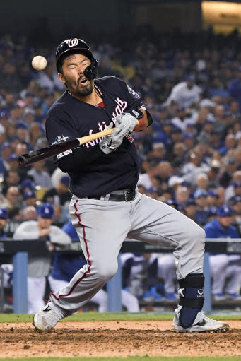 Washington Nationals' Kurt Suzuki gets hit by a pitch during the seventh inning in Game 5 of the baseball team's National League Division Series against the Los Angeles Dodgers on Wednesday, Oct. 9, 2019, in Los Angeles.(AP Photo/Mark J. Terrill)