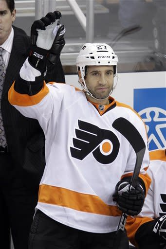 Philadelphia Flyers' Max Talbot (27) acknowledges fans during a tribute to his time with the Pittsburgh Penguins in the first period of an NHL hockey game in Pittsburgh, Thursday, Dec. 29, 2011. (AP Photo/Gene J. Puskar)