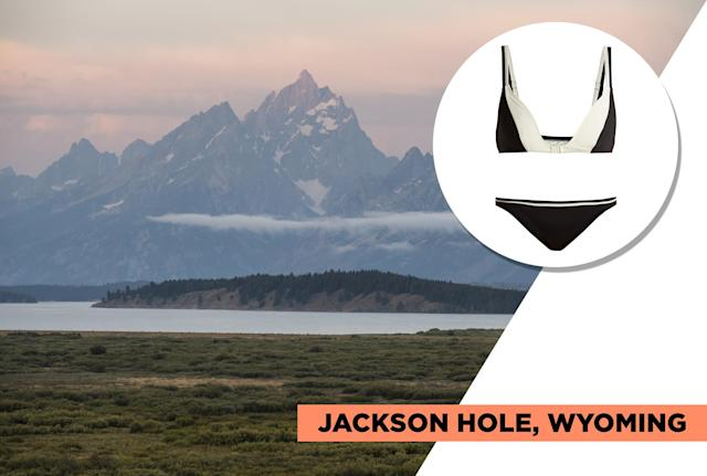 "<p>Jackson Hole is for the adventurous type. Not only was it the trendy spot Kanye West decided to launch his <em>Ye</em> album release party, but it's a place where you can go whitewater rafting, hiking, and fishing. Consider Solid & Striped's classic back-and-white bikini set for its universal style appeal. (Photo: Getty Images, Art: Quinn Lemmers for Yahoo Lifestyle)<br><br>Solid & Striped — The Nora Bikini Top, $78, <a href=""https://www.matchesfashion.com/us/products/Solid-%26-Striped-The-Nora-bikini-top-1219127"" rel=""nofollow noopener"" target=""_blank"" data-ylk=""slk:matchesfashion.com"" class=""link rapid-noclick-resp"">matchesfashion.com</a><br> Solid & Striped — The Nora Bikini Briefs, $78, <a href=""https://www.matchesfashion.com/us/products/Solid-%26-Striped-The-Nora-bikini-briefs--1219128"" rel=""nofollow noopener"" target=""_blank"" data-ylk=""slk:matchesfashion.com"" class=""link rapid-noclick-resp"">matchesfashion.com</a> </p>"