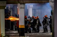 Brazilian police clash with demonstrators outside the Carrefour supermaket where a black man was beaten to death by security guards, in Porto Alegre, Rio Grande do Sul, Brazil, on November 20, 2020