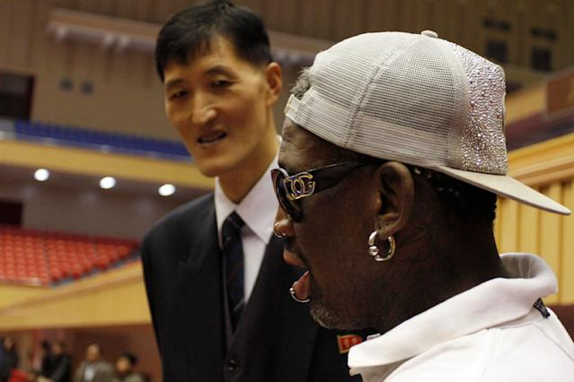 Dennis Rodman, right, meets with former North Korean basketball player Ri Myung Hun at a practice session with USA and North Korean players in Pyongyang, North Korea on Tuesday, Jan. 7, 2014. Rodman came to the North Korean capital with a squad of USA basketball stars for an exhibition game on Jan. 8, the birthday of North Korean leader Kim Jong Un. (AP Photo/Kim Kwang Hyon)