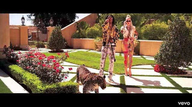 "In 2013, rap trio Migos released a song called ""Versace,"" which became a mega radio and club hit. This image, taken from the song's music video, shows the artists wearing the boldly printed designs of the Versace fashion house. (Photo: MigosVEVO)"