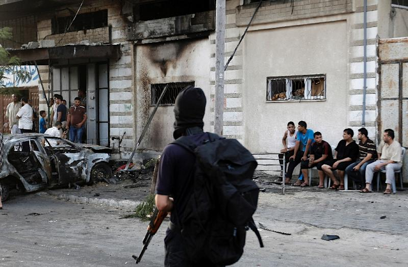 According to witnesses, the five explosions in Gaza City on July 19, 2015 occurred within an interval of 15 minutes and three of the cars were said to have belonged to members of Al-Qassam and two to members of Al-Quds (AFP Photo/Mohammed Abed)