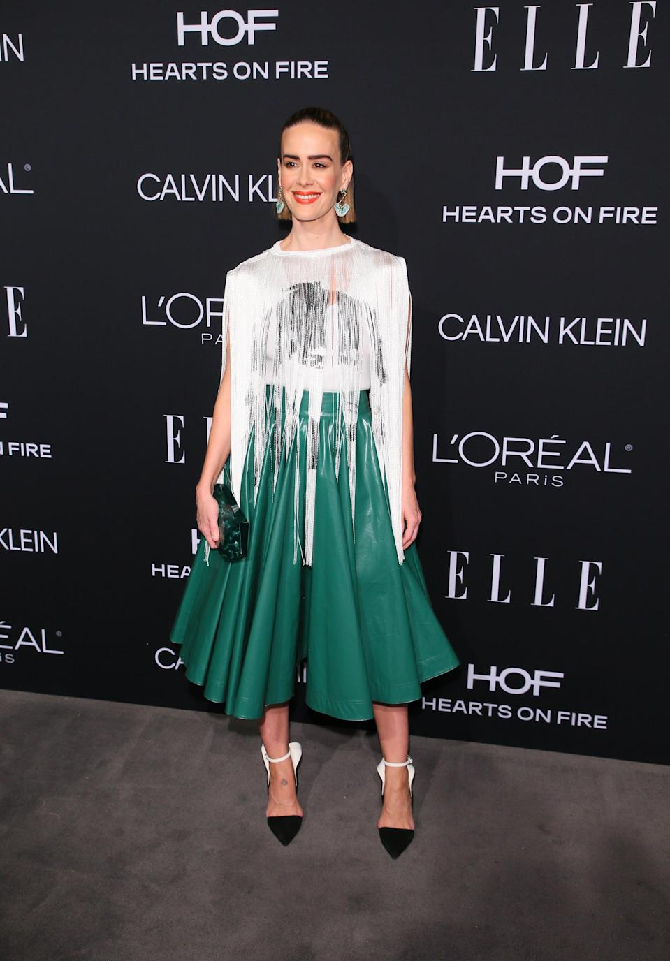 <p>On October 15, Sarah Paulson wore a glitzy Calvin Klein dress for the 25th Annual ELLE Women in Hollywood Celebration. The actress finished the ensemble with slicked back hair and a lick of red lipstick. <em>[Photo: Getty]</em> </p>