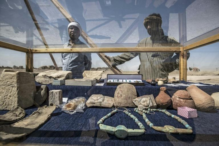 Archaeologists have unearthed items of jewellery, coloured pottery vessels, scarab beetle amulets and mud bricks bearing seals of Amenhotep III