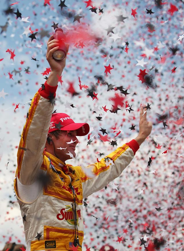 TORONTO, ON - JULY 08: Ryan Hunter-Reay, driver of the #28 Team DHL/Sun Drop Citrus Soda Chevrolet, celebrates winning during the IZOD INDYCAR Series Honda Indy Toronto on July 8, 2012 in Toronto, Canada. (Photo by Nick Laham/Getty Images)