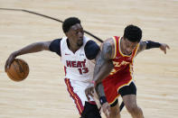 Miami Heat center Bam Adebayo (13) drives to the basket against Atlanta Hawks forward John Collins (20) during the second half of an NBA basketball game, Tuesday, March 2, 2021, in Miami. (AP Photo/Wilfredo Lee)