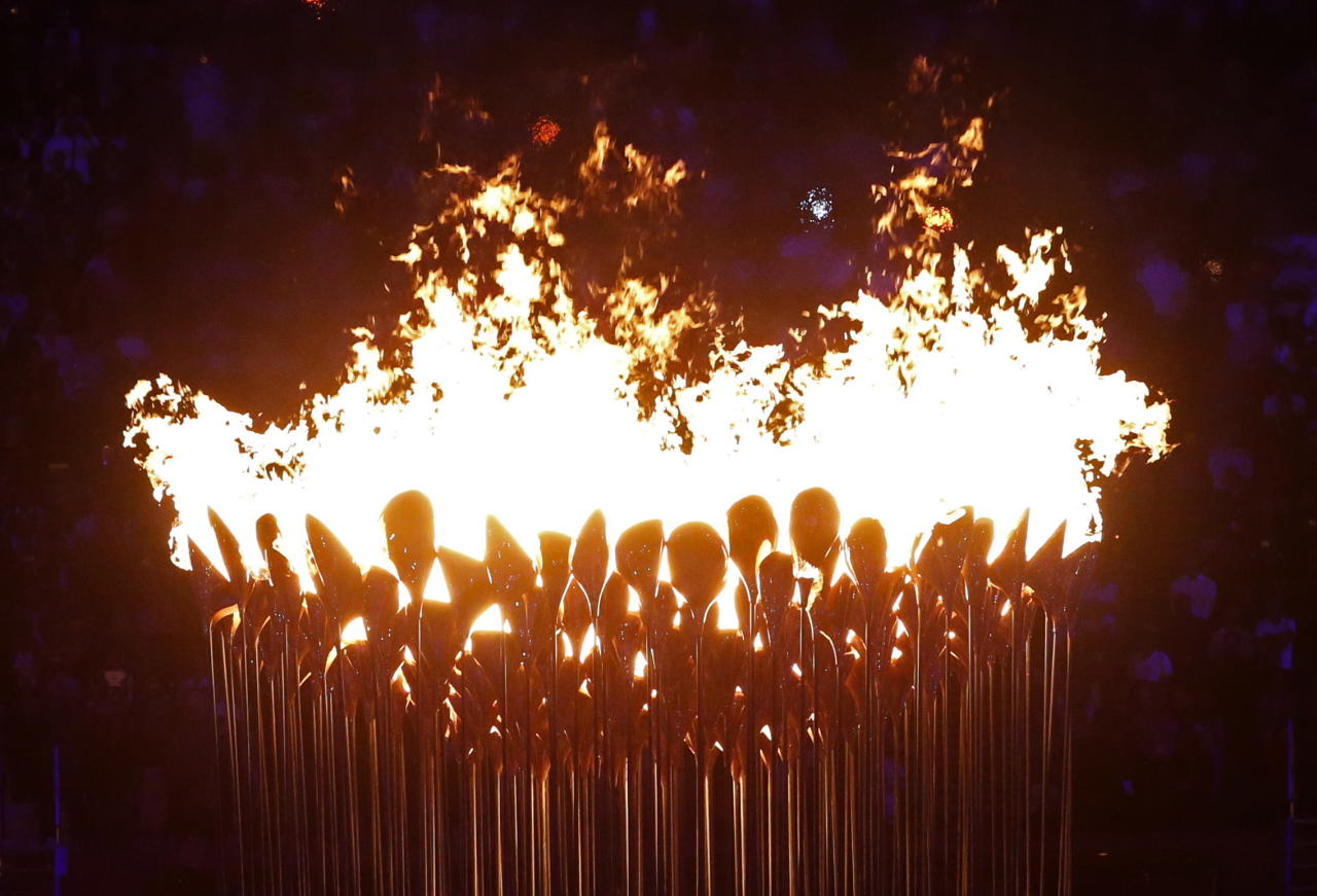 The Olympic cauldron burns after being lit during the Opening Ceremony at the 2012 Summer Olympics, Saturday, July 28, 2012, in London. (AP Photo/Jae C. Hong)