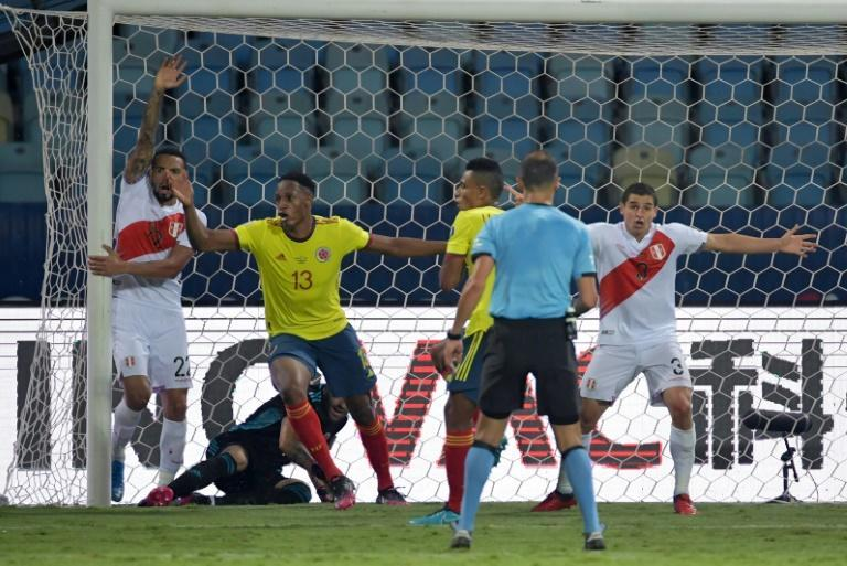 Peru's players celebrate after Colombia's Yerry Mina (2nd left) scored an unfortunate own goal that won the game