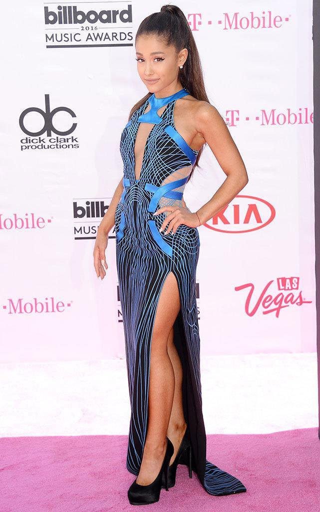"""<p>Could you walk in that dress and those shoes? The """"Dangerous Woman"""" singer almost took a tumble on the pink carpet but recovered nicely with a toss of her signature ponytail. Grande's dress is on trend with cutouts and is giving <a href=""""http://www.schlockmania.com/wp-content/uploads/2010/12/Tron-03.jpg"""" rel=""""nofollow noopener"""" target=""""_blank"""" data-ylk=""""slk:major vintage Tron vibes"""" class=""""link rapid-noclick-resp"""">major vintage <i>Tron</i> vibes</a>. <i>(Photo: Broadimage/REX/Shutterstock)</i></p>"""