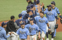 Tampa Bay Rays players, third from left to right, Brandon Lowe, Joey Wendle, Ji-Man Choi, Diego Castillo and Mike Zunino celebrate a win over the Philadelphia Phillies during a baseball game Sunday, May 30, 2021, in St. Petersburg, Fla. (AP Photo/Steve Nesius)