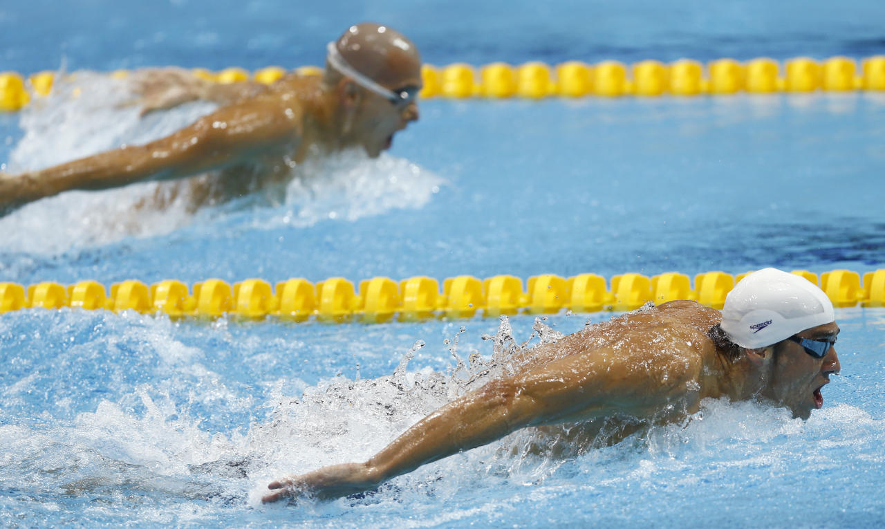 USA's Michael Phelps leads Hungary's Laszlo Cseh in a heat of the men's 400-meter individual medley at the Aquatics Centre in the Olympic Park during the 2012 Summer Olympics in London, Saturday, July 28, 2012. (AP Photo/Daniel Ochoa De Olza)
